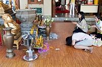 Thai People Praying, Wat Pho Temple of the Reclining Buddha Bangkok , Thailand