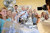 Senior man celebrating start of retirement with family and friends