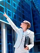 Beautiful business woman standing outdoor modern building