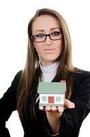 Business woman with small model of house