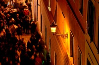 Typical scene in the city center of Rome where small streets gets busy with people passing by at night  Captured during the Christmas holiday season w...