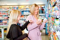 Young women smiling while shopping together