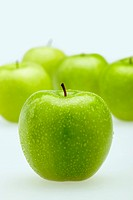 Green apples with water droplets