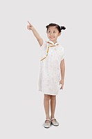 Girl in cheongsam smiling and pointing with finger