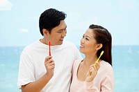 Man and woman holding toothbrush