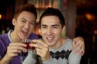 Men toasting drinks