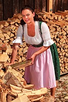 Woman in wood piles