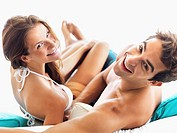 Couple relaxing on sofa together