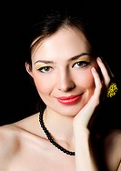 Portrait of the beautiful elegant girl with an evening make-up