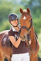 Hackney Horse. Chestnut horse with rider, portrait