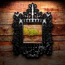 Retro frame on wooden wall