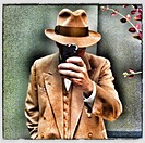 Caucasian man in old-fashioned clothing using cell phone