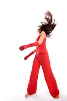 Woman dressed in red making acrobatic movements, performance