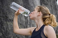 Woman drinking bottled water, Elbe Sandstone Mountains, Saxony, Germany, Europe