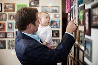Businessman and baby looking at pictures