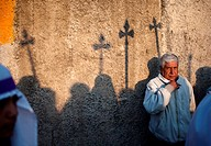Shadows of spears are cast in a wall as a man watches the Jesus Nazareno de la Merced procession during Easter Holy Week procession in Antigua Guatema...