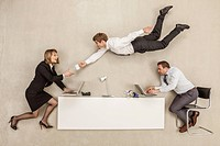 Business people working while another businessman providing cup