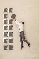 Businessman arranging files