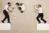 Business people jumping over platform gap