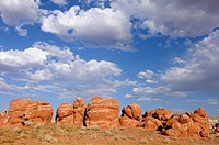 Sandstone boulders, sandstone formations, with cumulus clouds