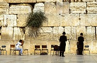 Two praying jews at the Wall at Jerusalem being photographed