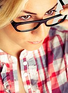 Blond young woman with glasses. Color.
