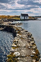 Boatkeepers office at the shore of a small lake in Connemara, near Maams Cross, County Galway, Ireland.