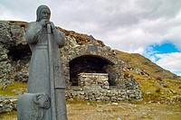 Statue of St. Patrick, Ireland´s patron saint, and an Altar, at Maumeen pass, Maamturk Mountains, County Galway, Ireland. Every year pilgrims climb to...