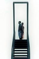 a couple on a diving platform.