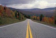 fall foliage, road, Vermont, The double yellow lines of Route 109 follow the colorful fall foliage through the scenic countryside of Belvedere.
