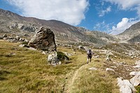 Man Hiking the GR 11 Footpath along the Vall d´Anglos in the Spanish Pyrenees - Huesca, Aragon, Spain.