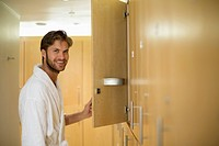 Portrait of a man smiling in a locker room of a spa