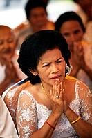 Mother of the bride at a buddhist wedding in a small village outside of Phnom Penh, Cambodia.