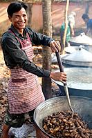 A Cambodian man prepares food for a buddhist wedding in a small village outside of Phnom Penh, Cambodia.