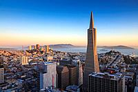 San Francisco skyline with Transamerica Pyramid with Golden Gate Bridge in the background at sunrise, California, USA
