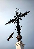 An eagle flies near the cross of the Hermitage of the Virgin of Rocio, in Almonte, Donana National Park, Huelva province, Andalusia, Spain, May 15, 20...