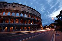 The Roman Colosseum and car light-trails, Rome, Lazio, Italy.