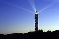Lighthouse with light beam in the night, Amrum, Northfrisian Islands, Schleswig-Holstein, Germany, Europe.