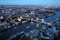 Aerial view of London at night with the Tower Bridge in the foreground, England, Great Britain, United Kingdom, Europe.