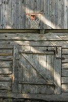 Wood cabin with basketball net