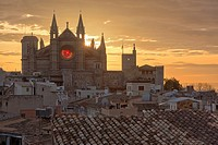 13th century Gothic cathedral of Palma de Majorca. Winter solstice sunrise when sun light aligns with both main rose windows. West facade. Majorca, Ba...