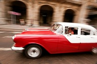 Dynamic scene of an old american car, Prado, Havana, Cuba, West Indies, Central America.