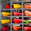 Kayaks stacked on a rack out of water.