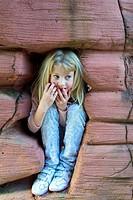 young girl happy playing hide and seek,cleveleys,lancashire,england,uk,europe.