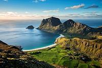 View of Vik and Haukland beaches from summit of Holandsmelen mountain peak, Vestvagoy, Lofoten Islands, Norway.