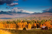 Fall foliage landscape with Mt. Mansfield in the background, Stowe, Vermont, USA.