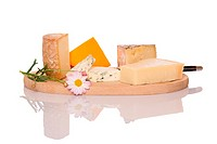 Composition of French cheese on wooden board.