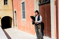 A bagpipes maker and player plays his bagpipes in the old town city centre of Scapoli, in the region of Molise in Italy