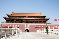 Tiananmen Square, Gate of Heavenly Peace with Mao's Portrait and guard, Beijing, China.