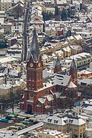 Winter - City view of snow-covered church / parish church of St. John the Baptist (Sauerländer Dom) in the old town of Arnsberg in North Rhine-Westpha...